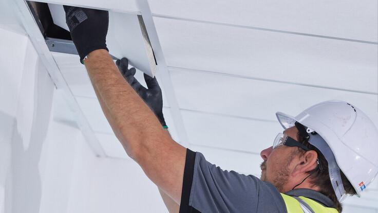 Suspended ceiling installer in the UK installing Rockfon Tropic A Edge. Installer, installing, ceiling, tiles